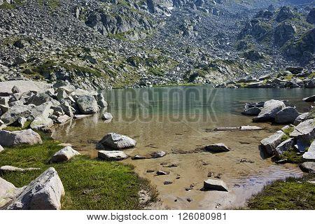 Clean waters of Argirovo Lake, Pirin mountain, Bulgaria
