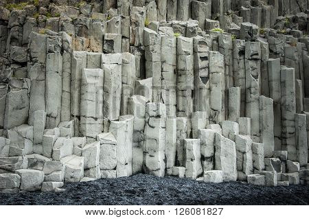 Basalt rock cliff on a black sand beach in Vik, Iceland