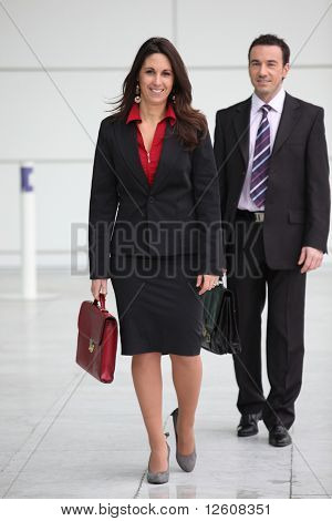 Men and businesswoman in the lobby of a company