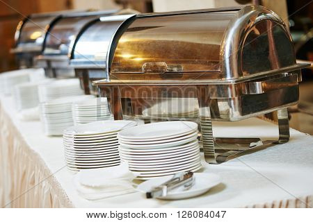 Food catering service. Buffet table with pans