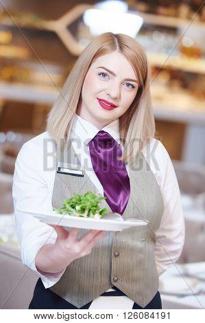 Waitress serving banquet table