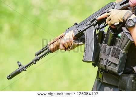 Hands of military soldier with assault rifle