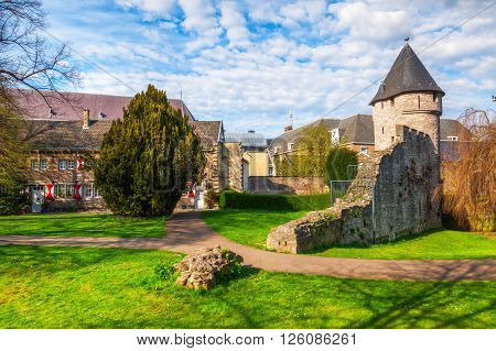cityscape with medieval city wall in Maastricht Netherlands