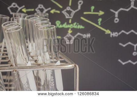 Test Tubes In Front Of Blackboard