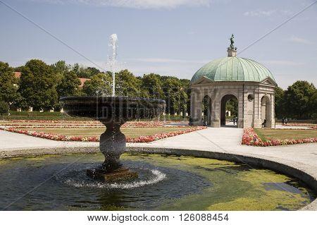 quiet garden with beautiful fountain, hofgarten munchen germany