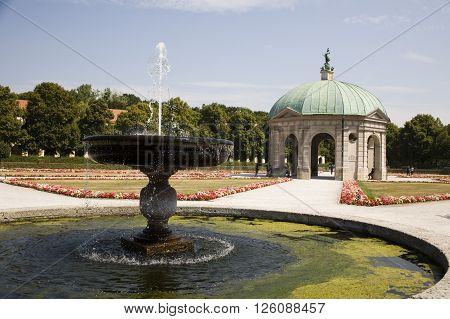 quiet garden with beautiful fountain, hofgarten munchen germany