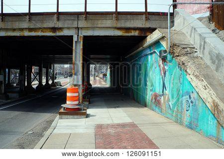 JOLIET, ILLINOIS / UNITED STATES - APRIL 12, 2015: Pedestrians may walk through the Jefferson Street Viaduct in downtown Joliet.