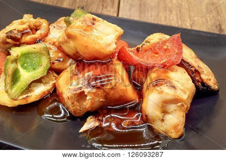 Barbecue sea food with teriyaki sauce on the dish, Close up (fish, mussel, squid)