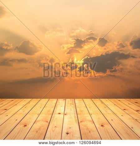 wood texture with beautiful landscape with the sun in the clouds.
