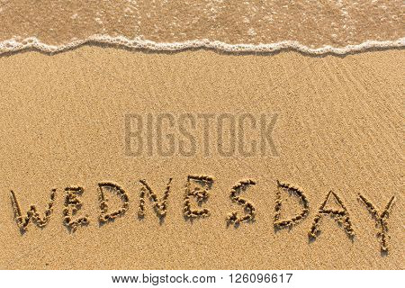 Wednesday - drawn of the hand on the beach sand, soft surf wave.