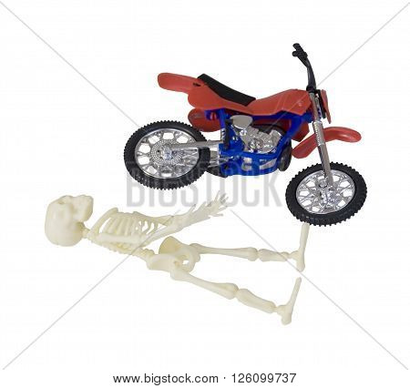 Skeleton laying on ground next to Motorcycle - path included