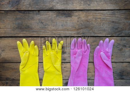 Latex cleaning gloves on wooden table background