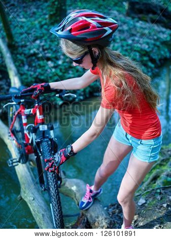 Bikes cycling girl cycling fording throught water .