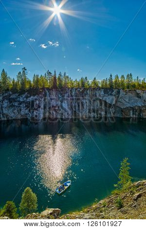 Tourist boat mouring in Marble Canyon under the sun