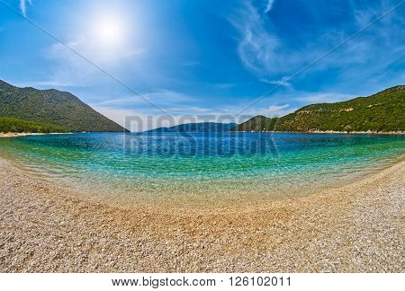 Abstract Empty Beach with clear transparent azure waters on a sunny day