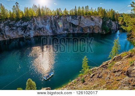 Tourist boat in astonishing Marble Canyon of Ruskeala in Karelia