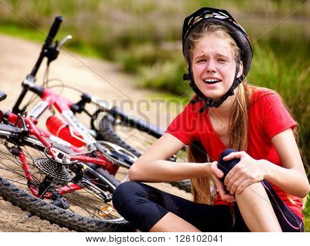 Bikes cycling girl wearing helmet. Girl girl fell off bike.