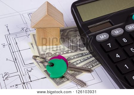 House shape made of wooden blocks home keys currencies dollar and calculator on electrical construction drawings of house calculation of cost building house