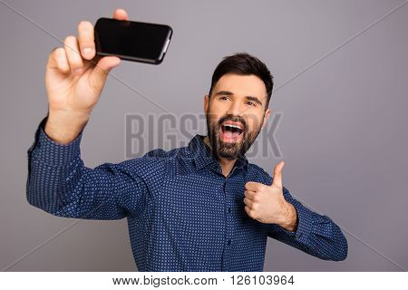 Happy Young Man Making Funny Selfie And Showing Thumb Up