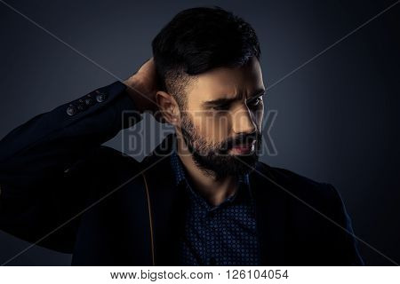 Close Up Portrait Of Brutal Handsome Man Touching His Hair