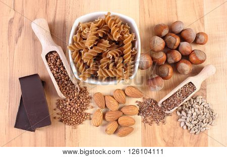 Ingredients and products containing magnesium and dietary fiber healthy food and nutrition wholemeal pasta buckwheat linseed almonds hazelnut chocolate