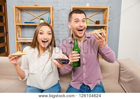 Surprised Happy Family Watching Film And Eating Pizza With Beer