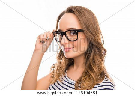 Portrait  Of Attractive Brainy Young Woman Touching Her Glasses