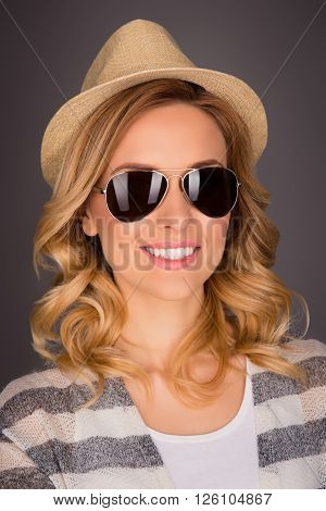 Close Up Portrait Of Cheerful Young Happy Woman  In Hat And Spectacles