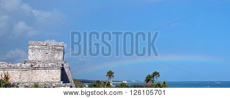 Rainbow next to Castillo Temple at Tulum Mexico Mayan Ruins
