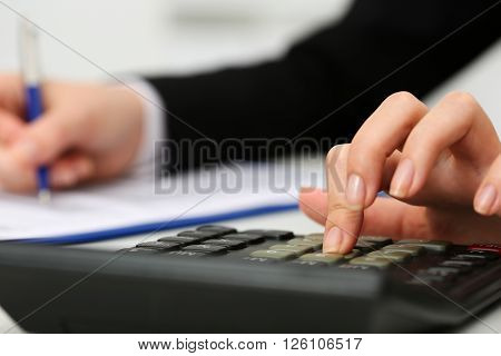 Female Accountant Hand Holding Pen Counting On Calculator