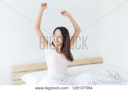 Woman wake up at morning