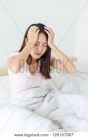 Asian woman suffer from headache