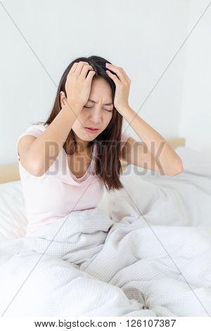 Asian woman suffer from headache