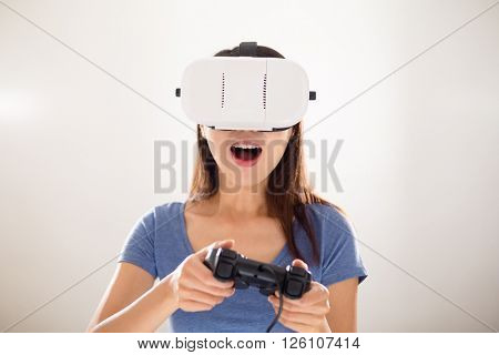 Female play video game with wearing VR device