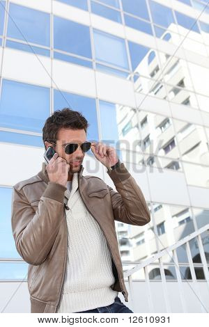 Portrait of a young man with mobile phone