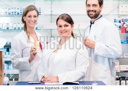 Team of pharmacists in drug store checking pharmaceuticals