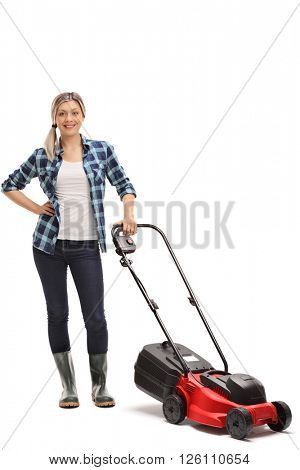 Full length portrait of a young woman posing with a red lawn mower isolated on white background