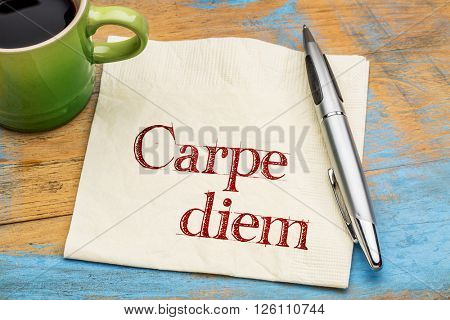 Carpe diem - handwriting on a napkin with a cup of coffee