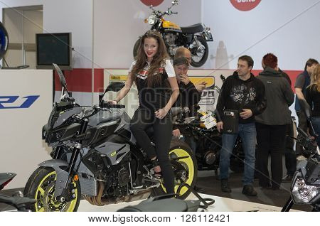 BRNO ,CZECH REPUBLIC-MARCH 4,2016: Beautiful hostess sits on motorcycle Yamaha MT 10 on International Fair for Motorcycles on March 4,2016 in Brno in Czech Republic