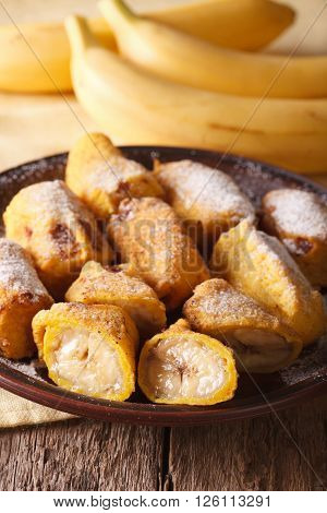 Fried Bananas Sprinkled With Powdered Sugar Close-up. Vertical