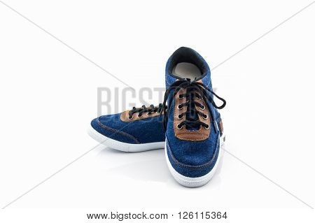 Blue sneakers on a white background. Canvas Shoe.
