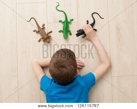 Boy Playing With  Toys - Lizard, Dinosaur, Crocodile
