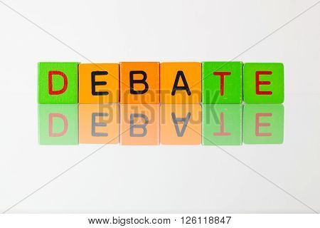 Debate - an inscription from children's wooden blocks