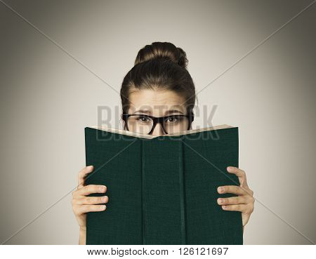 Open Book Hiding Face Woman Eyes Reading in Glasses on Gray Background