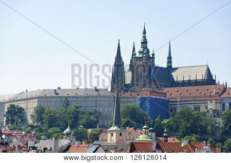 The view of Castle District of Prtague and St. Vitus Cathedral at sunny summer midday