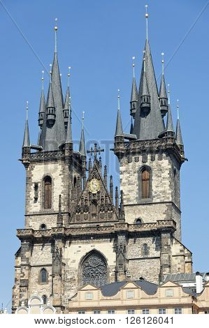 Upper part of bulding of Church of Our Lady Before Tyn in Prague against the blue sky