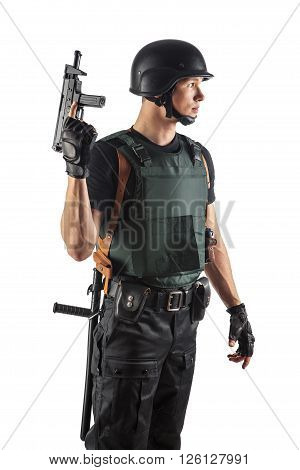 Police Officer In Body Armour Is Holding A Gun. Isolated On White.