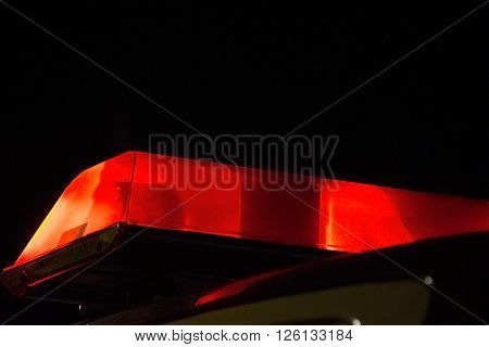 Red Police siren beacon light flashing on car