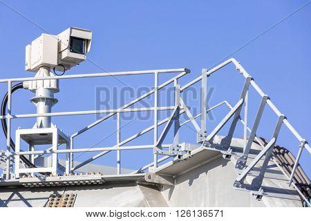 CCTV security camera over blue sky