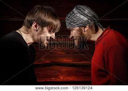 Confrontation. Conceptual picture. Two brutal man looking into each other's eyes
